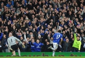 Cahill celebrates the 3rd goal in front of the home supporters